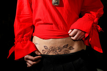 The Wider Image: Chinese mothers tattoo over C-section scars