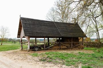 Dry hay stacks in rural wooden barn interior