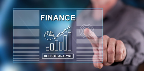 Man touching a finance concept on a touch screen