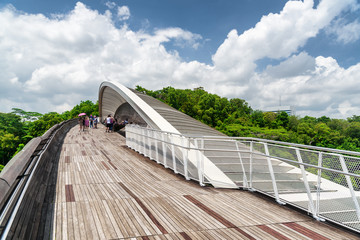 Bridge imitating wave. Wooden walkway leading to park, Singapore