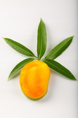 Mango shape with  sliced fruit with leaves