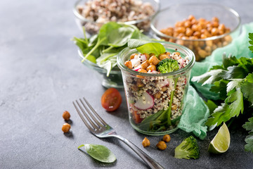 Quinoa salad with chickpeas in mason jar, spinach, veggies, healthy vegan food, dieting, clean eating, vitamin and protein snack