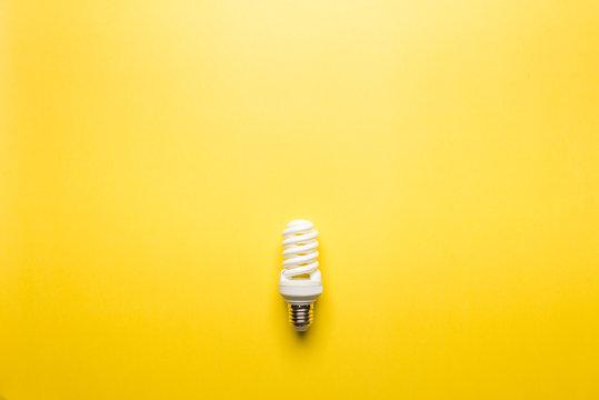 Lightbulb on yellow background.