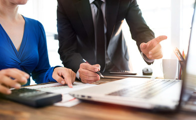 Businessman And Businesswoman Working In Office Together In Cooperation