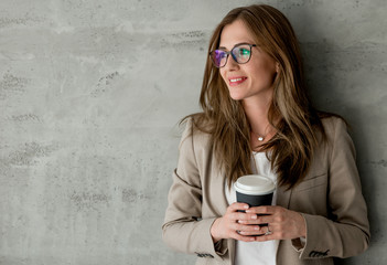 Business woman with coffee cup