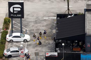 FBI officials walk through Pulse gay night club parking lot in Orlando