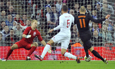 Holland's Arjen Robben scores against England during their international friendly soccer match at Wembley Stadium in London