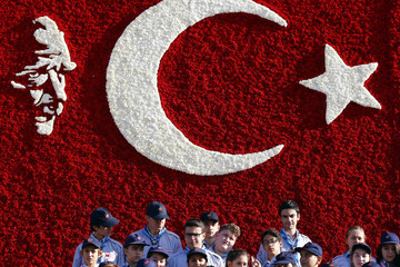 Scouts stand at attention during a ceremony at the mausoleum of Ataturk, marking the anniversary of his death, in Ankara