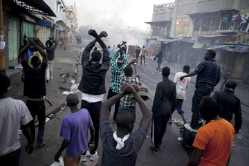 Anti-government protestors gesture to the police during clashes in Senegal's capital Dakar
