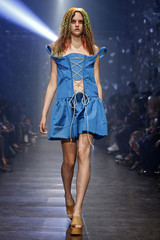 A model presents a creation by British designer Vivienne Westwood as part of her Spring/Summer 2016 women's ready-to-wear fashion collection in Paris
