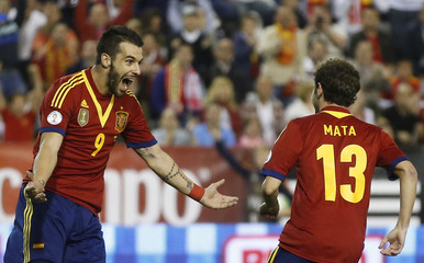 Spain's Juan Mata celebrates his goal with his teammate Alvaro Negredo during their 2014 World Cup qualifying soccer match against Georgia at Carlos Belmonte stadium in Albacete