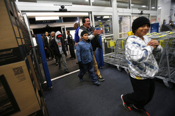 Holiday shoppers enter Best Buy during Black Friday in San Francisco