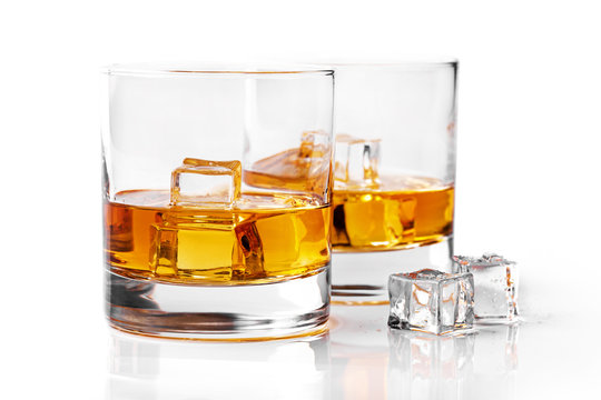 whiskey glasses with ice cubes isolated on white background