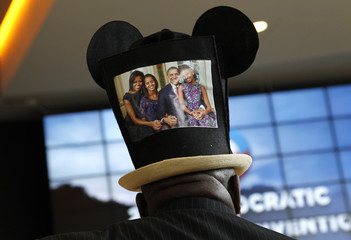 Convention-goer sports a family picture on his Mickey Mouse tophat as he awaits the start of the first day of the Democratic National Convention in Charlotte