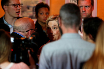 Democratic U.S. presidential candidate Hillary Clinton speak to a supporter after a meeting with community leaders in Oakland, California