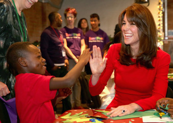 Britain's Catherine, Duchess of Cambridge takes part in group activities as she attends the Anna Freud Centre Family School Christmas Party at Anna Freud Centre, in London