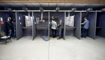 Several shooters target practice with guns at the Ringmasters of Utah gun range