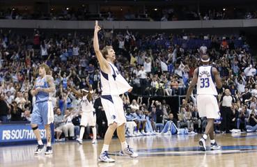 Mavericks forward Nowitzki celebrates after hitting a three point shot in their NBA basketball game in Dallas