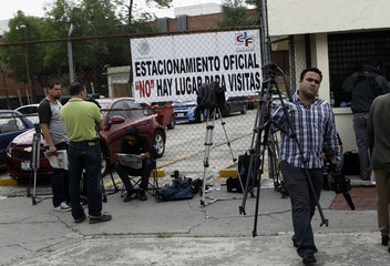 Journalists wait for news outside the entrance of the Reclusorio Oriente prison, where Andres Granier, former governor of Tabasco state, is attending his judicial hearing inside a court in Mexico City