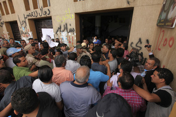 Lawyers, members of the judiciary and civil society society organisations try to enter a court building in Benghazi