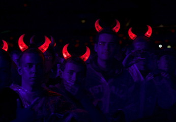 Fans of veteran rock band AC/DC wear flashing devils horns during the band's first concert in Australia on their 'Rock or Bust' world tour in Sydney