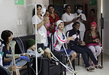 Oncology patients and nurses sing happy birthday in honour of former Cuban leader Castro at Havana's Fajardo Hospital