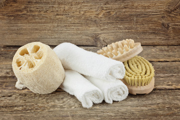 Spa composition with massage brushes on wooden background, weight loss and skin care concept