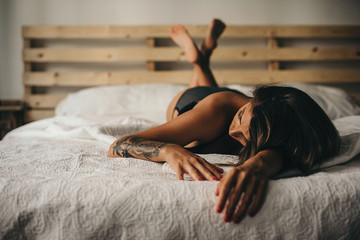 Sleepy hot woman in bed