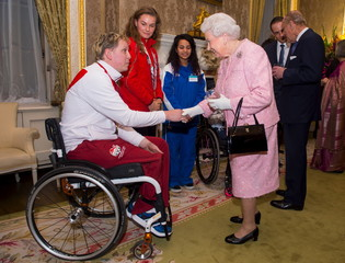 Queen Elizabeth II meets Commonwealth Games athletes England's Brown, Wales' O'Loughlin and Scotland's Gabell at the annual Commonwealth Day reception at Marlborough House in London
