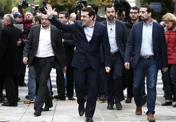 Newly appointed Greek PM and winner of the Greek parliamentary elections, Alexis Tsipras, waves as he arrives for a swearing in ceremony by members of his cabinet at the presidential palace in Athens