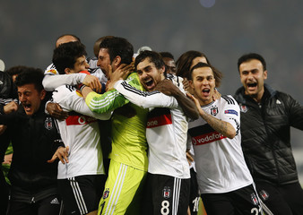 Players of Besiktas and goalkeeper Gonen celebrate victory in their Europa League round of 32 second leg soccer match against Liverpool in Istanbul