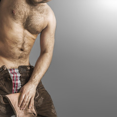 hairy man in bavarian leather pants