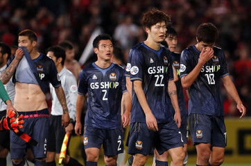FC Seoul players react after losing their Asian Champions League soccer semi-final game against the Western Sydney Wanderers at Parramatta Stadium