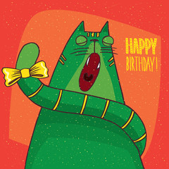 Funny green cat with yellow bow on its tail sits in full face and yawns with closed eyes. Red background and inscription Happy Birthday! Hand drawn in comic style