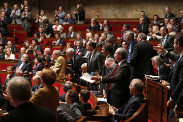 French UMP deputies react as they prepare to walk out of the hemicycle at National Assembly in Paris
