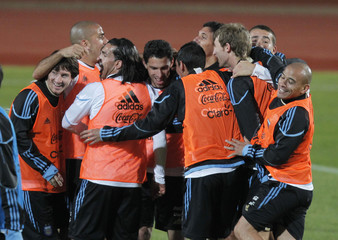 Argentina's soccer players embrace each other after a training session in Pretoria