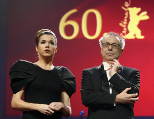 German actress Engelke and Berlinale festival director Kosslick talk to the audience during the opening gala of the 60th Berlinale International Film Festival in Berlin