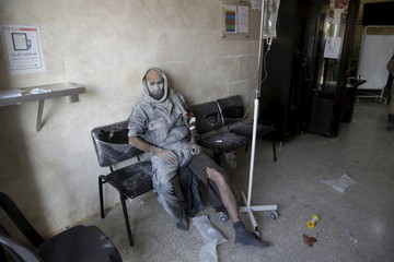 An injured man rests in a field hospital after what activists said were airstrikes carried out by the Russian air force in Khan al-Sebil