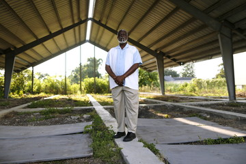 Reverend Charles Duplessis poses for a picture at the construction site of his fellowship's new church, the Mount Nebo Bible Baptist Church, in the Lower Ninth Ward neighborhood of New Orleans, Louisiana