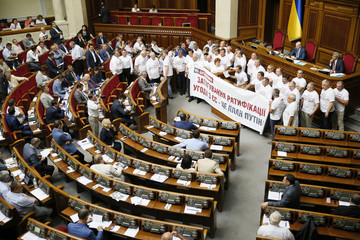 Members of Batkivshchyna (Fatherland) political party hold a banner during a session of the parliament in Kiev