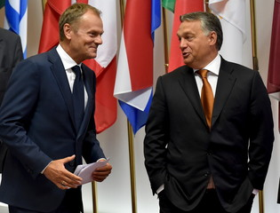 European Council President Tusk and Hungary's PM Orban arrive for a news conference ahead of their meeting in Brussels