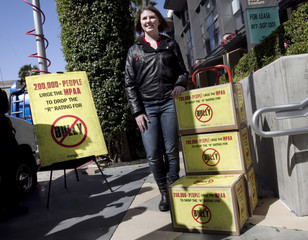 High school student Katy Butler poses with boxes containing more than 210,000 petition signatures to the Motion Picture Association of America (MPAA), to urge them to to lower the rating of the anti-bullying documentary ÒBullyÓ from ÒRÓ to ÒPG-13.Ó,
