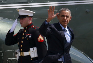 U.S. President Barack Obama waves before boarding a plane at the tarmac of the international airport in Manila