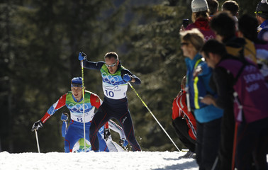 Frances Vittoz and Russias Legkov ski during the mens 30 km pursuit cross-country final at the Vancouver 2010 Winter Olympics in Whistler