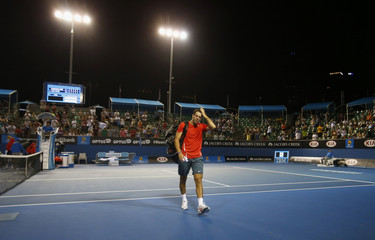 Juan Martin Del Potro of Argentina leaves after being defeated by Roberto Bautista Agut of Spain after their men's singles match at the Australian Open 2014 tennis tournament in Melbourne