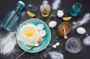 Overhead food composition with eggs and flour. Dough preparation flat lay