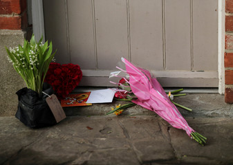 Flowers are seen by the front door of George Michael's house, where he died on Christmas Day, in Goring