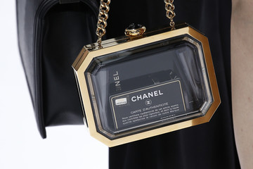 The handbag of an unidentified guest is pictured at the Grand Palais which is transformed into a Chanel airport before German designer Karl Lagerfeld's Spring/Summer 2016 women's ready-to-wear collection for French fashion house Chanel in Paris
