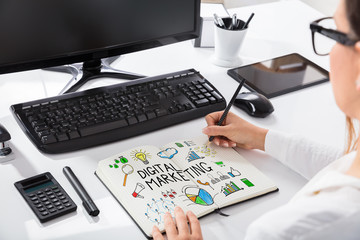 Woman Drawing Digital Marketing Chart On Notebook