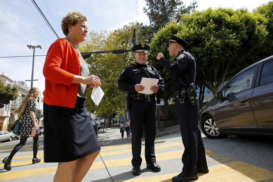 San Francisco police chief Suhr looks over notes prior to a news conference near Lombard Street in San Francisco
